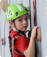 Kid on a Rock Climbing Wall